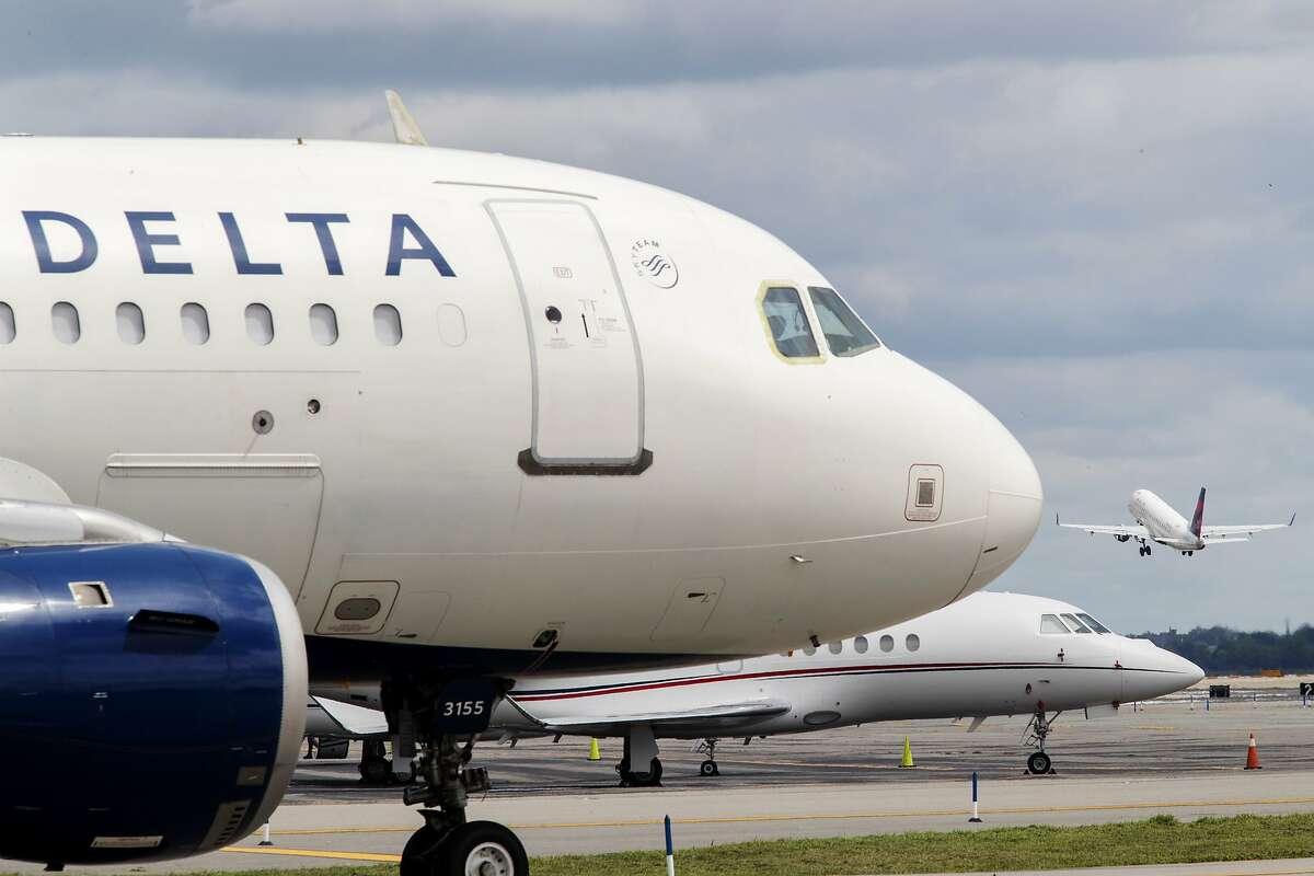 FILE - In this Aug. 8, 2017, file photo, a Delta Air Lines jet waits on the tarmac at LaGuardia Airport in New York. Delta tops an annual study that ranks US airlines by on-time arrivals, complaint rates, and other statistical measurements. Researchers who crunch the numbers say that U.S. airlines are getting better as a whole. (AP Photo/Mary Altaffer, File)