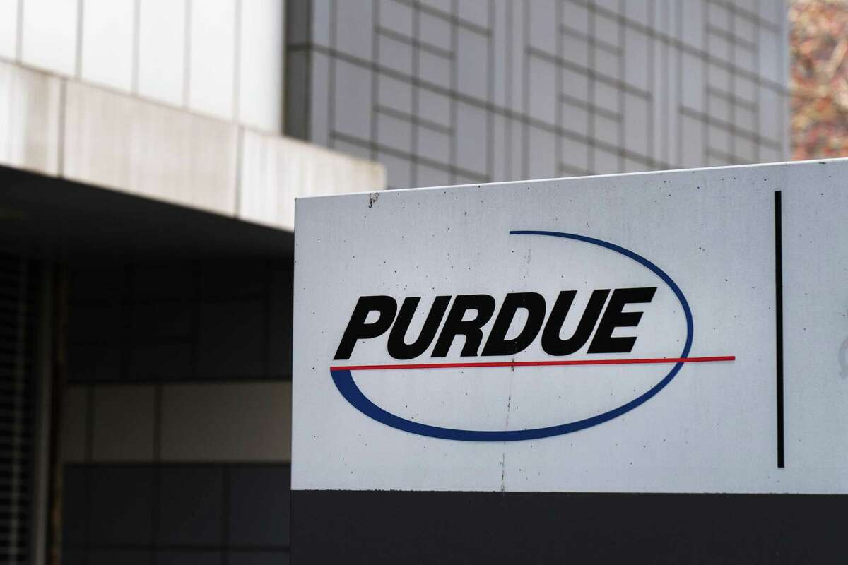 Purdue Pharma-branded signs, such as this one, have been taken down in recent weeks outside Purdue's headquarters at 201 Tresser Blvd., in downtown Stamford, Conn.