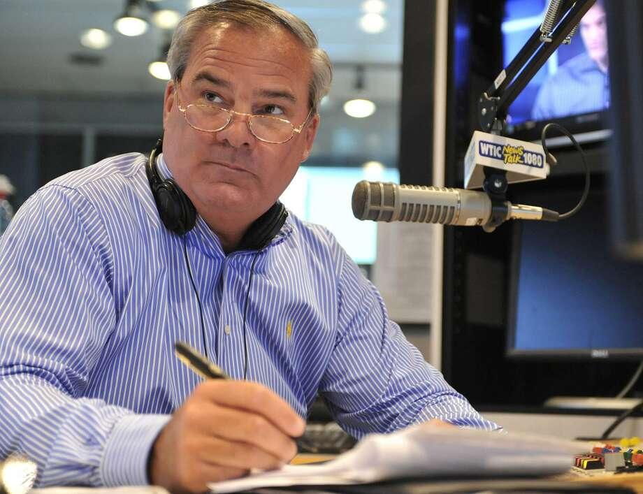 Former Connecticut Gov. John Rowland fills in as a talk show host on WTIC AM radio in Farmington, Conn., Friday, July 2, 2010. Photo: AP Photo/Jessica Hill / AP Photo/Jessica Hill / Associated Press