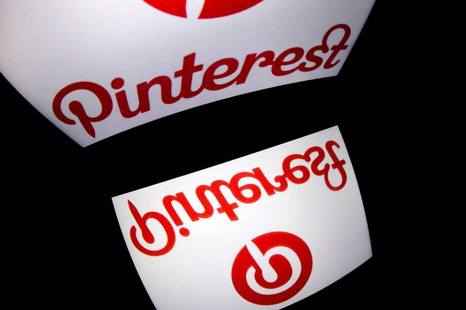 "(FILES) In this file photo taken on January 2, 2014 the logo of mobile app ""Pinterest"" is displayed on a tablet in Paris. Photo: Lionel Bonaventure, AFP/Getty Images"