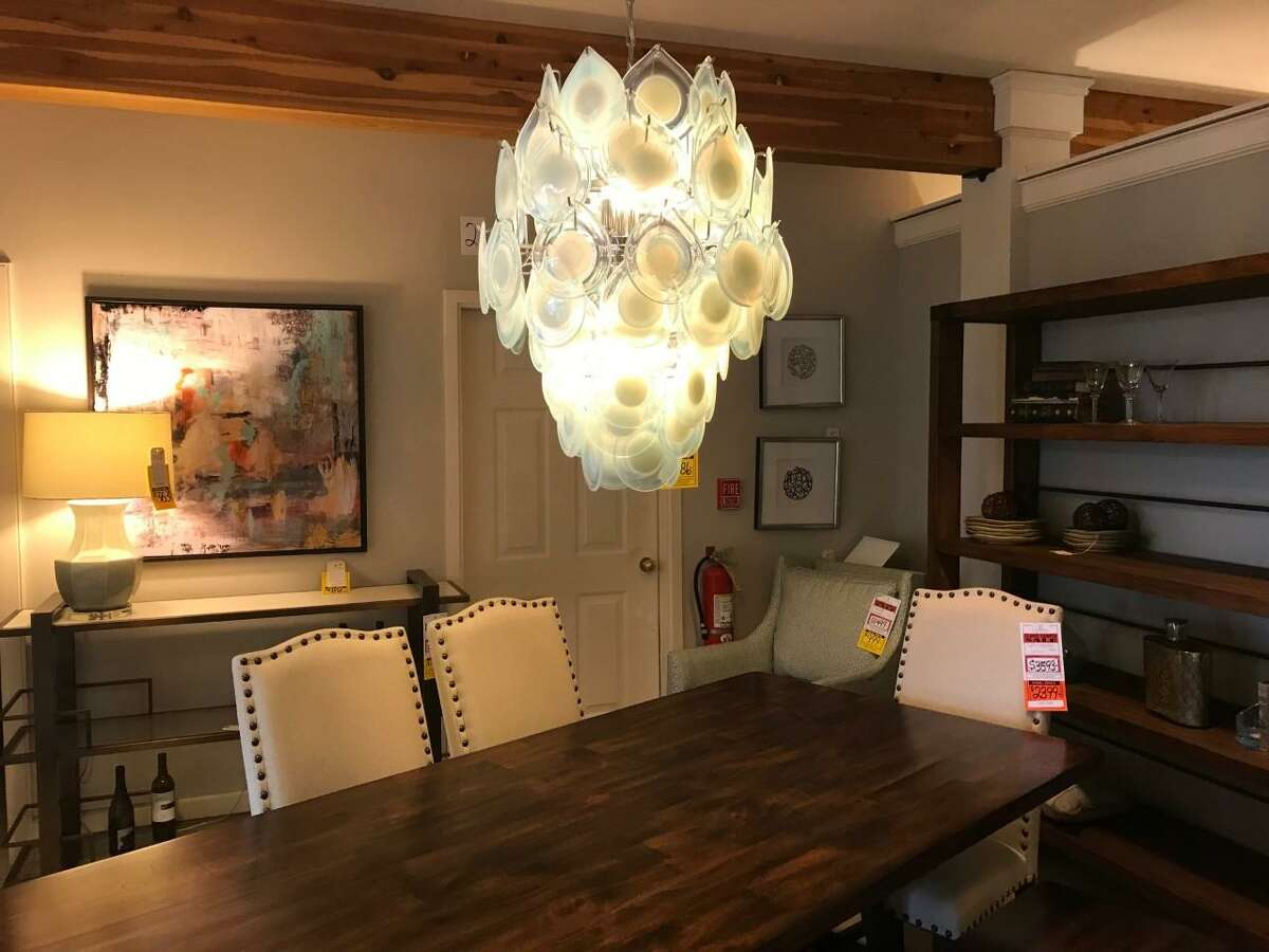 A dining room set on display at Furniture Barn in Cheshire. The store, which has been in business since 1966, is closing later this year, according to the owners of the business.