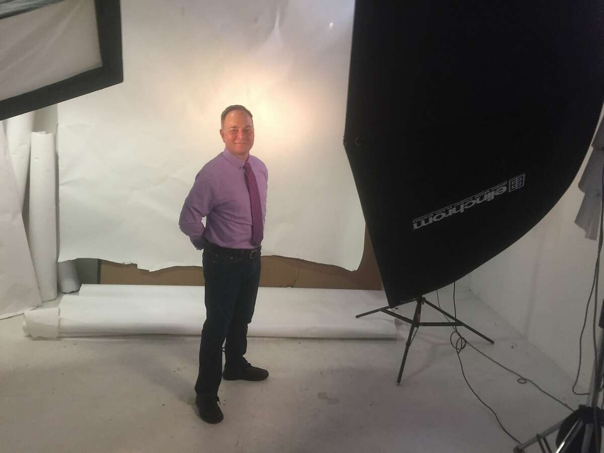 """Columnist Kevin Fisher-Paulson has his portrait taken at The Chronicle wearing his """"writer"""" tie."""