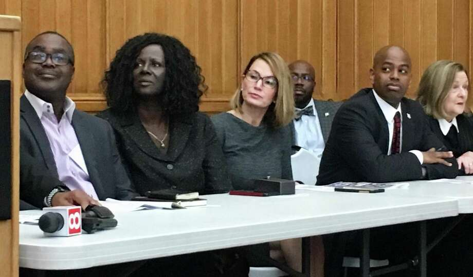 On the same day as a vote on marijuana legalization by the legislature's judiciary committee, the Connecticut Black Clergy Alliance held Black Clergy Day at the Capitol in Hartford. At center were Rep. Patricia Billie Miller, D-Stamford, and Rep. Themis Klarides, the House minority leader. Miller, not a member of the alliance, gave the invocation, referring to the divisive marijuana issue, and later cast a vote against a legalization bill. Photo: Dan Haar/Hearst Connecticut Media