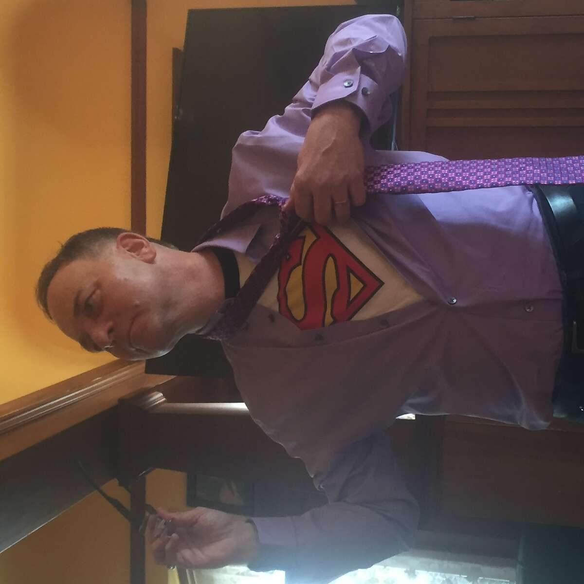 """Columnist Kevin Fisher-Paulson in an outfit his husband Brian calls his """"Clark Kent drag."""""""