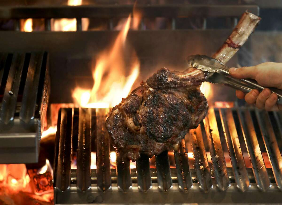 A tomahawk steak being grilled at Niku on Wednesday, March 27, 2019, in San Francisco, Calif.