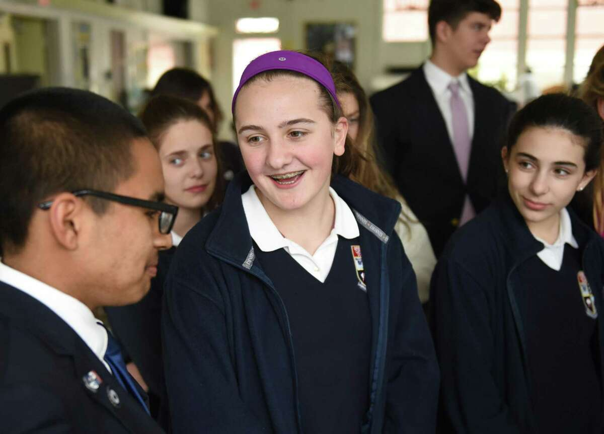 Eighth-grader Ellie Balestriere speaks about the influence of Pope Francis in between classes at Greenwich Catholic School in Greenwich, Conn. Wednesday, March 23, 2016.