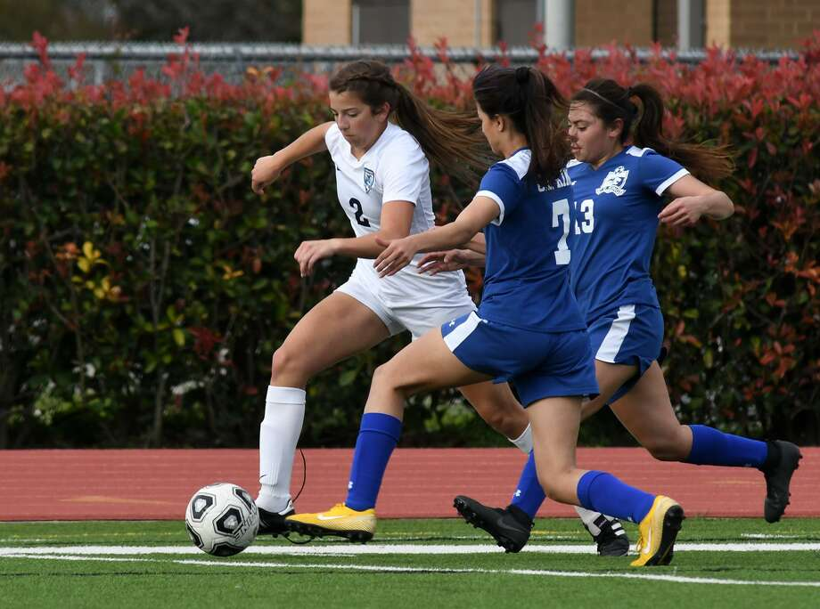 Kingwood sophomore Jenna Bodron (2) pushes the ball ahead of C.E. King defenders Wendy Becerra (7) and Faviola Gamboa (13) during the first half of their Region III-6A Bi-District Playoff matchup at Crenshaw Memorial Stadium in Houston on March 29, 2019. Photo: Jerry Baker, Houston Chronicle / Contributor / Houston Chronicle