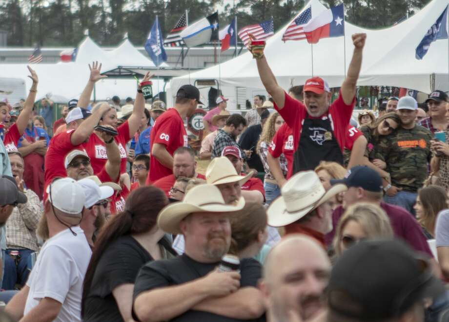 Members of Top Hand Cookers celebrate as they make their way through the crowd after being awarded 1st place for ribs during the awards ceremony for the Bud Light BBQ Cook-Off on  Saturday, April 6, 2018, at the Montgomery County Fair & Rodeo in Conroe. Photo: Cody Bahn/Staff Photographer