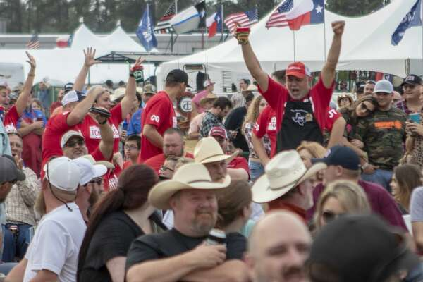 Members of Top Hand Cookers celebrate as they make their way through the crowd after being awarded 1st place for ribs during the awards ceremony for the Bud Light BBQ Cook-Off on Saturday, April 6, 2018, at the Montgomery County Fair & Rodeo in Conroe.