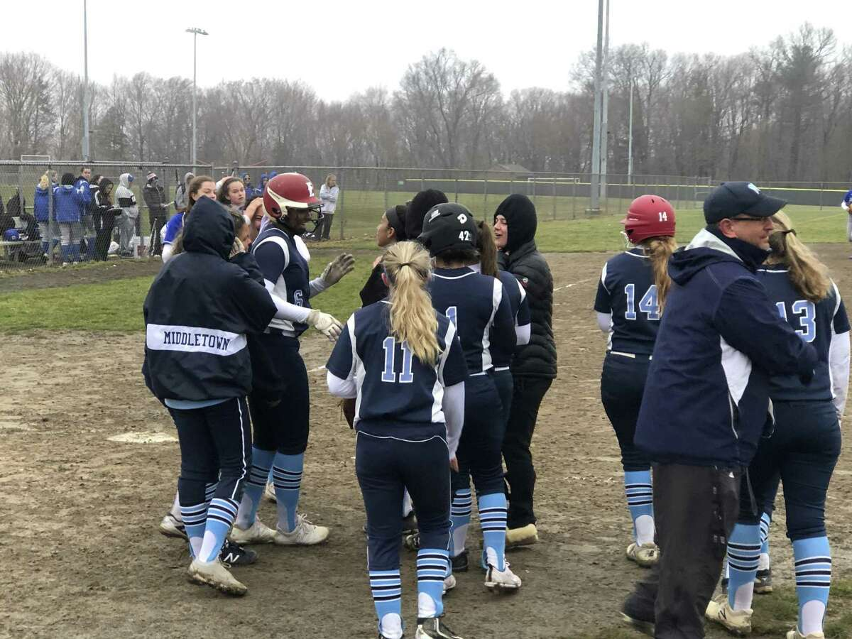 Dominique Highsmith (6) is greeted by teammates after her walk-off solo home run lifted Middletown to a 10-9 win.