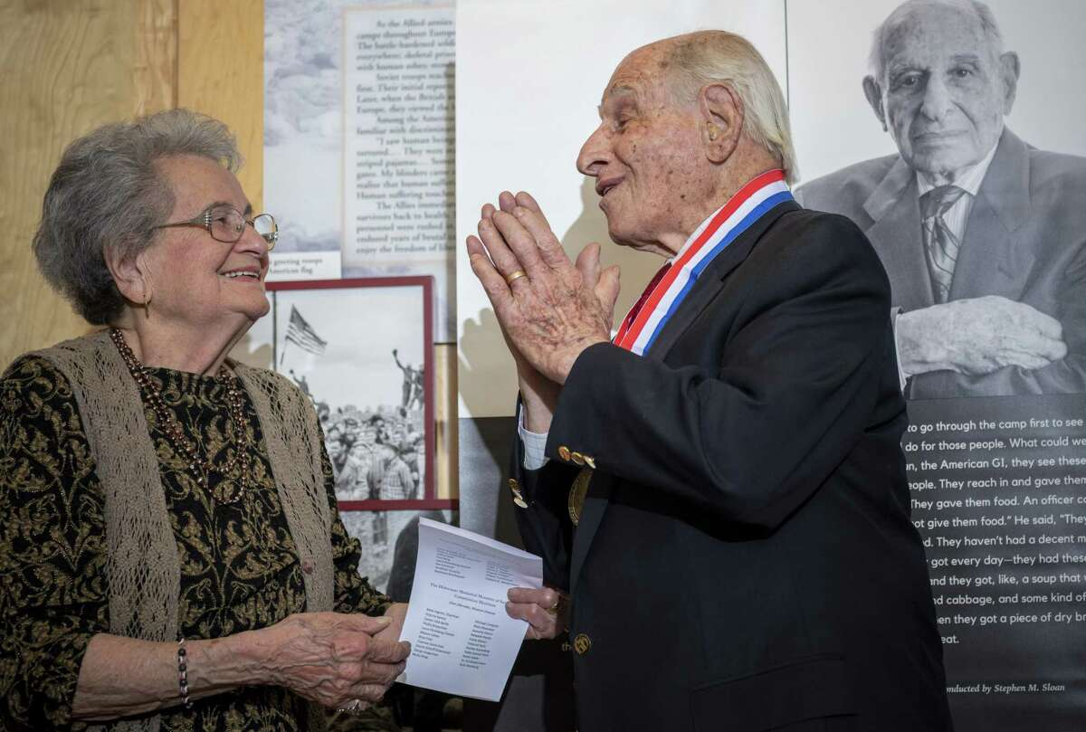 """Holocaust survivor Anna Rado (left) presents Gerd Miller with the """"Texas Liberator Medal"""" during a ceremony by the Texas Holocaust and Genocide Commission at the Holocaust Memorial Museum of San Antonio. The commission honored Miller, a World War II veteran from San Antonio, for helping to liberate the Dachau, Ebensee and Mauthausen concentration camps."""