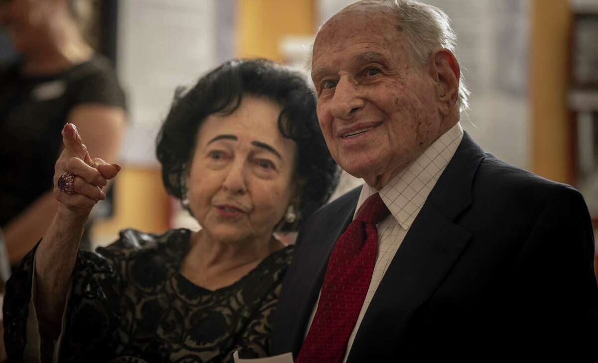 Gerd Miller and his wife, Dorothy, see someone they know before a ceremony begins Monday, organized by The Texas Holocaust and Genocide Commission to honor Miller, a World War II veteran from San Antonio, for helping to liberate the Dachau, Ebensee and Mauthausen concentration camps.