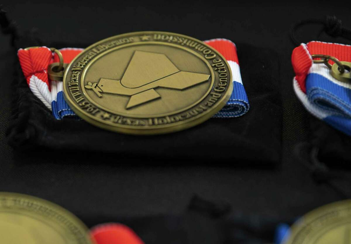 """The """"Texas Liberator Medal"""" is presented to World War II veterans from Texas who helped liberate the Dachau, Ebensee and Mauthausen concentration camps. It was presented Monday to Gerd Miller of San Antonio by the Texas Holocaust and Genocide Commission at a ceremony at the Holocaust Memorial in San Antonio."""