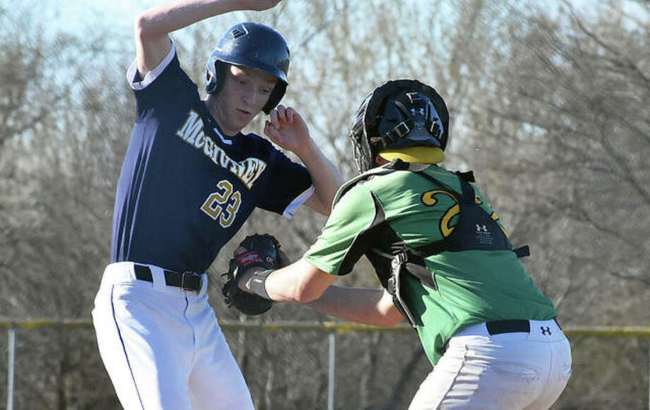 Father McGivney's Zach Brasel, left, looks to avoid the tag of Southwestern catcher Trever Seets in the third inning in Brighton. Photo: Matt Kamp/The Intelligencer