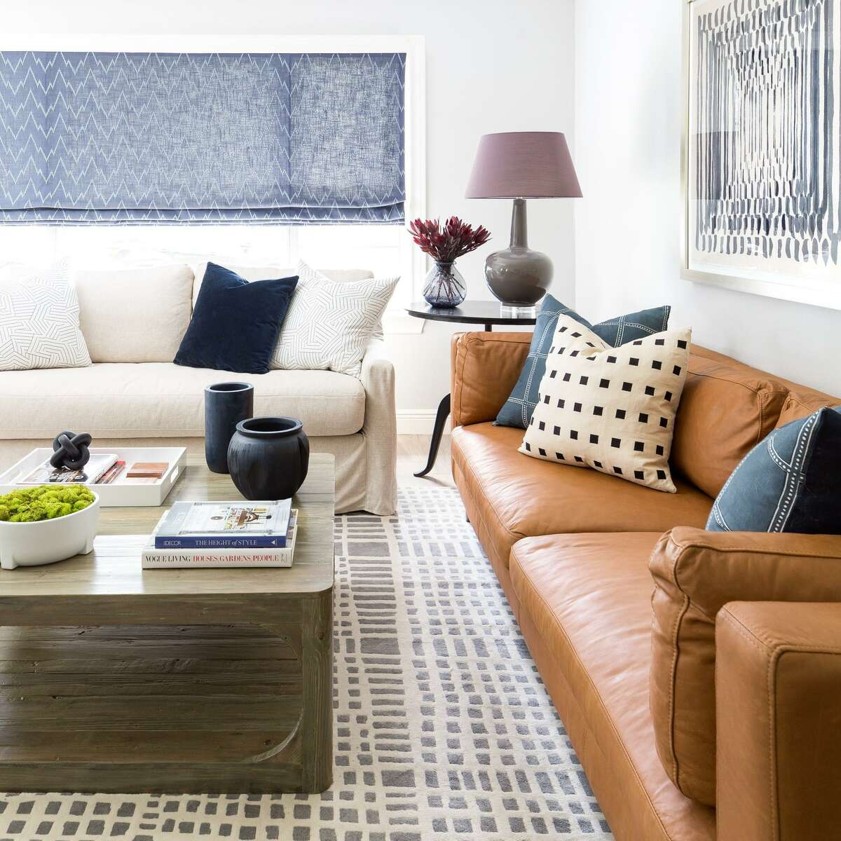 After photo of the living room of Jay Dobbs. It was designed by Lacey Michalek of Lacey Michalek Interiors.