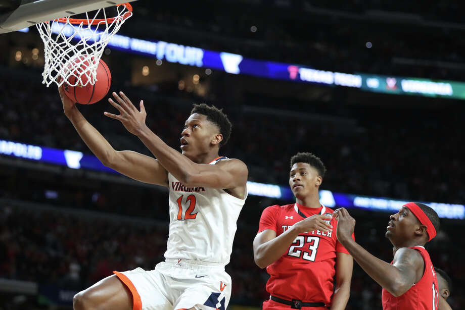 University of Virginia's De'Andre Hunter (12) scores against Texas Tech's Jarrett Culver (23) and Tariq Owens (11) during the NCAA Division I Men's Basketball championship, April 8, 2019, at U.S. Bank Stadium in Minneapolis. James Durbin / Reporter-Telegram Photo: James Durbin / Midland Reporter-Telegram / ? 2019 All Rights Reserved