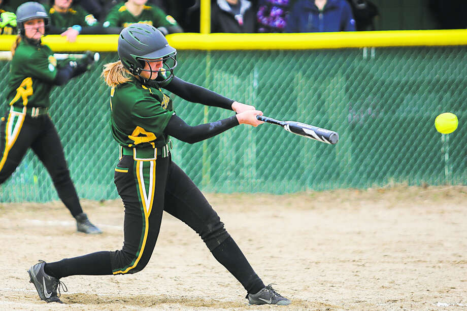 In this Daily News file photo, Dow High's Krista Moe gets a hit last Thursday vs. Grand Blanc. Photo: Katykildee/kildee@mdn.net