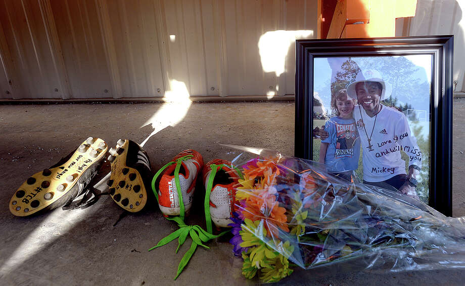 Mementos fill a bench during the vigil in honor of soccer coach and Nederland graduate Rico Keeling, 29, who passed away unexpectedly at his home Sunday night. Keeling was a coach and trainer to many youth soccer players throughout the area. Many of them, along with family and friends gathered at the Cris Quinn Soccer Complex for the memorial Monday. Photo taken Monday, April 8, 2019 Kim Brent/The Enterprise Photo: Kim Brent/The Enterprise
