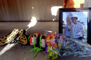 Mementos fill a bench during the vigil in honor of soccer coach and Nederland graduate Rico Keeling, 29, who passed away unexpectedly at his home Sunday night. Keeling was a coach and trainer to many youth soccer players throughout the area. Many of them, along with family and friends gathered at the Cris Quinn Soccer Complex for the memorial Monday. Photo taken Monday, April 8, 2019 Kim Brent/The Enterprise
