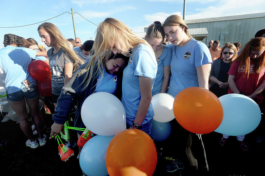 The crowd gather in a prayer during the vigil in honor of soccer coach and Nederland graduate Rico Keeling, 29, who passed away unexpectedly at his home Sunday night. Keeling was a coach and trainer to many youth soccer players throughout the area. Many of them, along with family and friends gathered at the Cris Quinn Soccer Complex for the memorial Monday. Photo taken Monday, April 8, 2019 Kim Brent/The Enterprise Photo: Kim Brent/The Enterprise