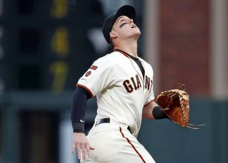 First baseman Tyler Austin tracks a popup hit by the Padres' Wil Myers in the first inning of his first Giants game. Austin told reporters that he hadn't seen Oracle Park before Monday.