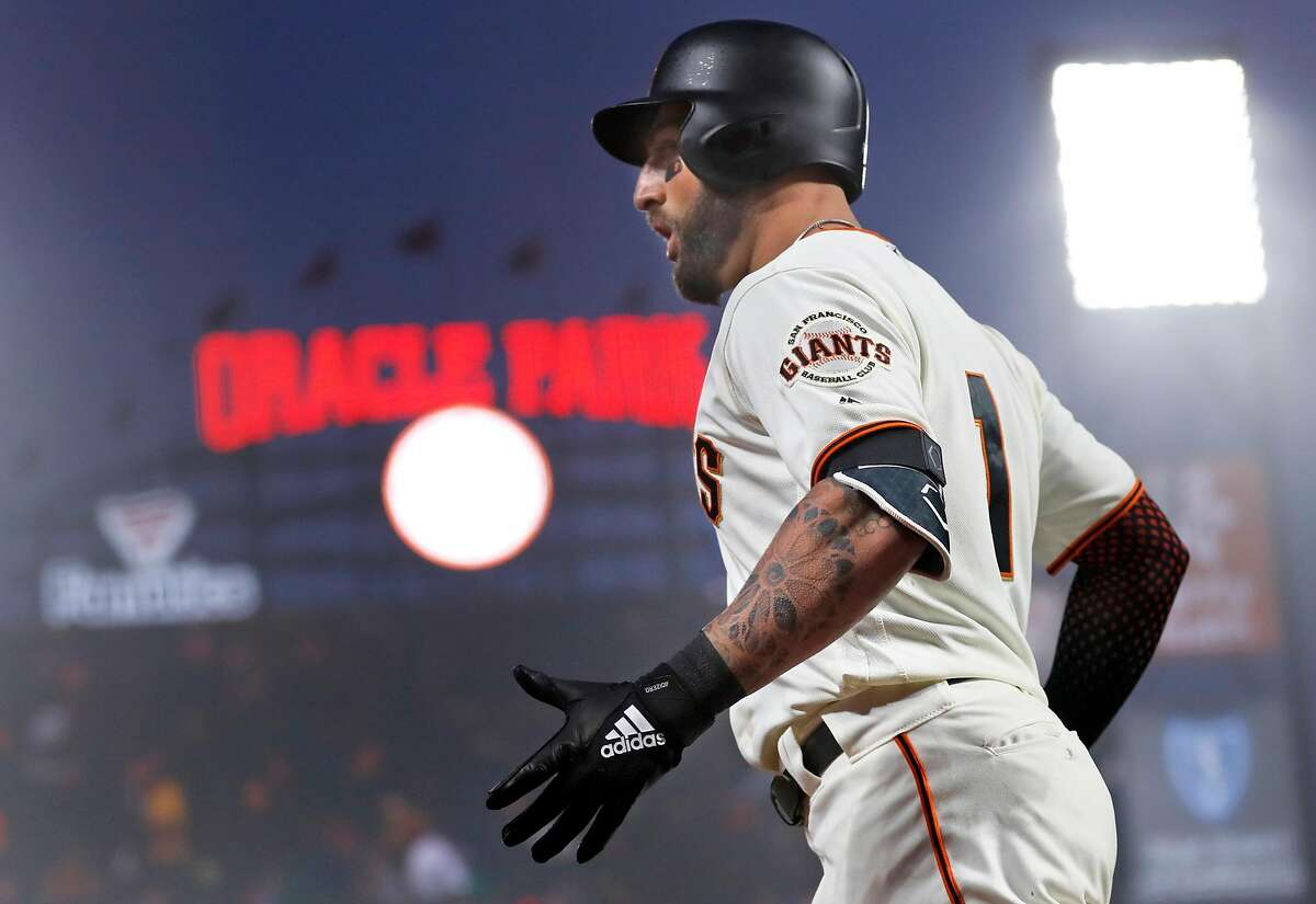 San Francisco Giants' Kevin Pillar reacts after hitting grand slam in 4th inning against San Diego Padres during MLB game at Oracle Park in San Francisco, Calif., on Monday, April 8, 2019.