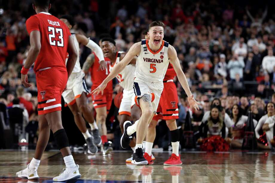 MINNEAPOLIS, MINNESOTA - APRIL 08: Kyle Guy #5 of the Virginia Cavaliers celebrate his teams 85-77 win over the Texas Tech Red Raiders to win the the 2019 NCAA men's Final Four National Championship game at U.S. Bank Stadium on April 08, 2019 in Minneapolis, Minnesota. (Photo by Streeter Lecka/Getty Images) Photo: Streeter Lecka, Staff / Getty Images / 2019 Getty Images