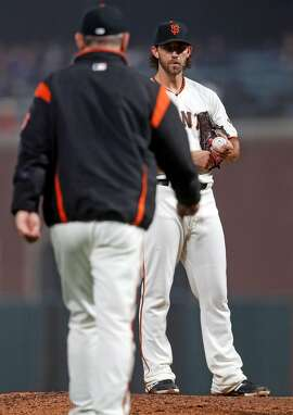 San Francisco Giants' Madison Bumgarner stares at manager Bruce Bochy during a 7th inning mound visit during MLB game against San Diego Padres at Oracle Park in San Francisco, Calif., on Monday, April 8, 2019.