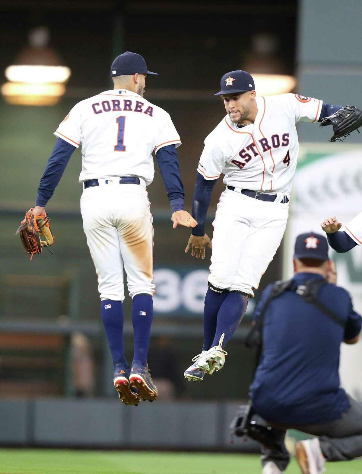 Houston Astros shortstop Carlos Correa (1) and Houston Astros center fielder George Springer (4) celebrate the team's 4-3 win over the New York Yankees on Monday, April 8, 2019 in Houston. Astros won the game 4-3 and lead the series 1-0.