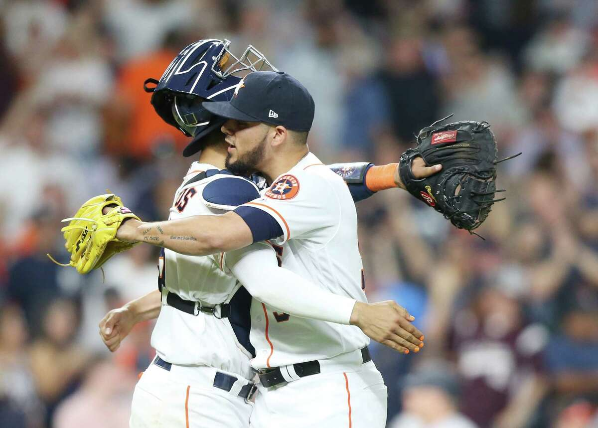 Houston Astros catcher Robinson Chirinos (28) hugs Houston Astros relief pitcher Roberto Osuna (54) after the last out against the New York Yankees at Minute Maid Park on Monday, April 8, 2019 in Houston. Astros won the game 4-3 and lead the series 1-0.