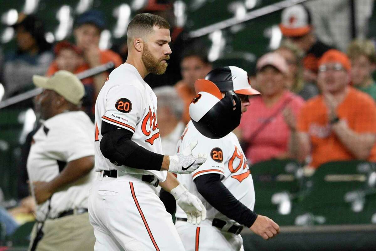 Baltimore Orioles' Chris Davis reacts after he struck out swinging during the eighth inning of a baseball game against the Oakland Athletics, Monday, April 8, 2019, in Baltimore. (AP Photo/Nick Wass)