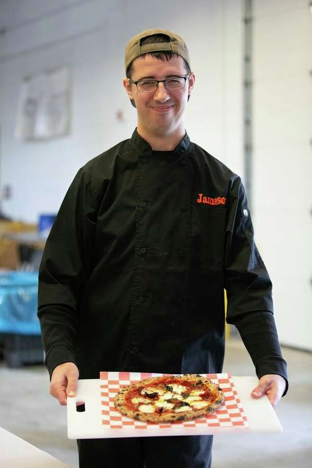 Jameson Baker, 23, works with his parents at Pizza Baker in Midland. (Photo provided)