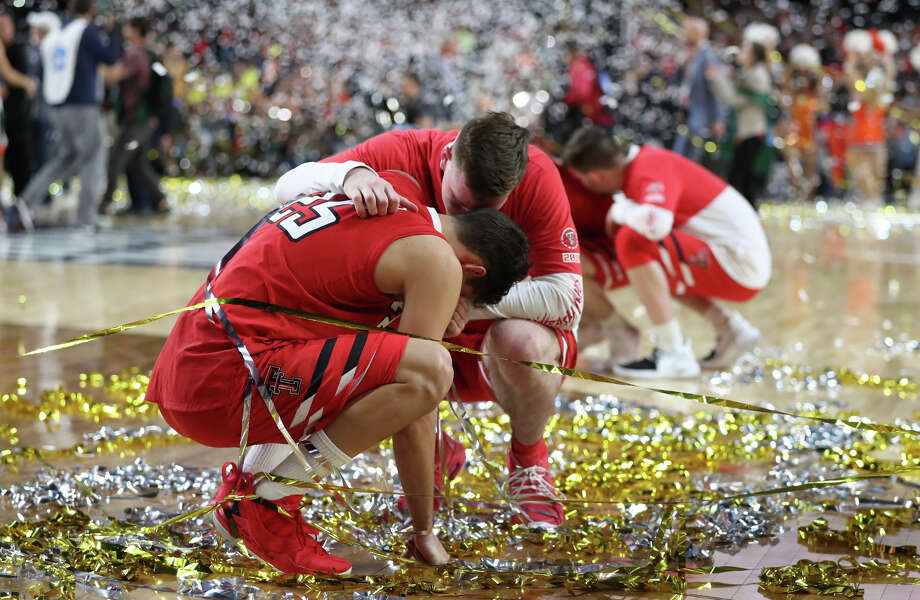 Texas Tech's Davide Moretti (25) is consoled by a teammate after losing to University of Virginia in the NCAA Division I Men's Basketball championship, April 8, 2019, at U.S. Bank Stadium in Minneapolis. James Durbin / Reporter-Telegram Photo: James Durbin / Midland Reporter-Telegram / © 2019 All Rights Reserved