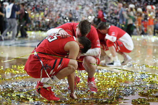 Texas Tech's Davide Moretti (25) is consoled by a teammate after losing to University of Virginia in the NCAA Division I Men's Basketball championship, April 8, 2019, at U.S. Bank Stadium in Minneapolis. James Durbin / Reporter-Telegram