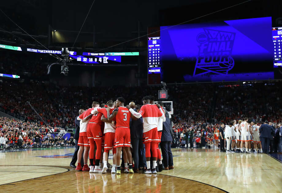 Texas Tech players talk strategy in overtime against University of Virginia during the NCAA Division I Men's Basketball championship, April 8, 2019, at U.S. Bank Stadium in Minneapolis. James Durbin / Reporter-Telegram Photo: James Durbin / Midland Reporter-Telegram / ? 2019 All Rights Reserved