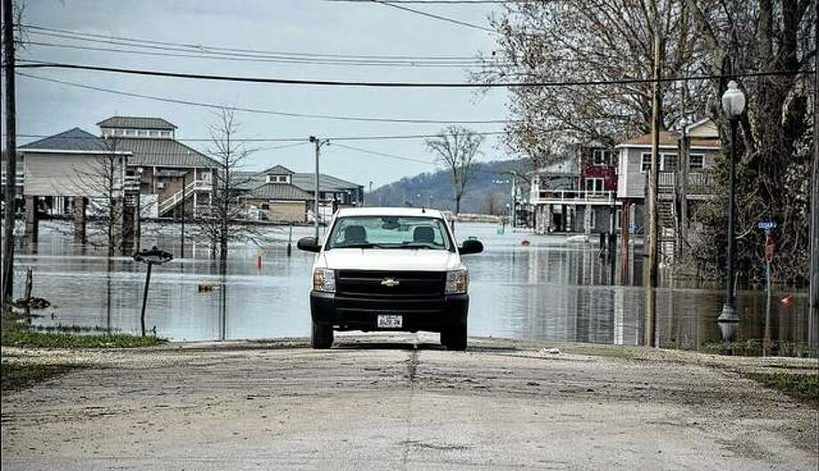 Floodwaters were receding Sunday in Grafton, but part of the town was still under water. Photo: David Blanchette | For Hearst Illinois