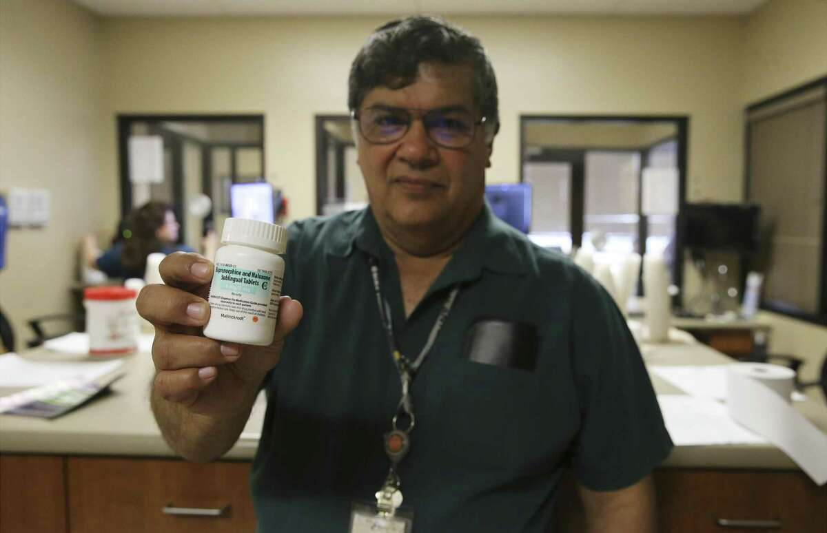 Ruben Gonzalez, manager of opiate addiction treatment services at the Restoration Center, holds a bottle of the drug, buprenorphine. Jennifer Ramirez, 34, says the drug has proved a life-changer for her as she recovers from a heroin addiction that began when she was 17. She receives her medication from Opiate Addiction Treatment Services, part of the Center for Health Care Services in Bexar County.