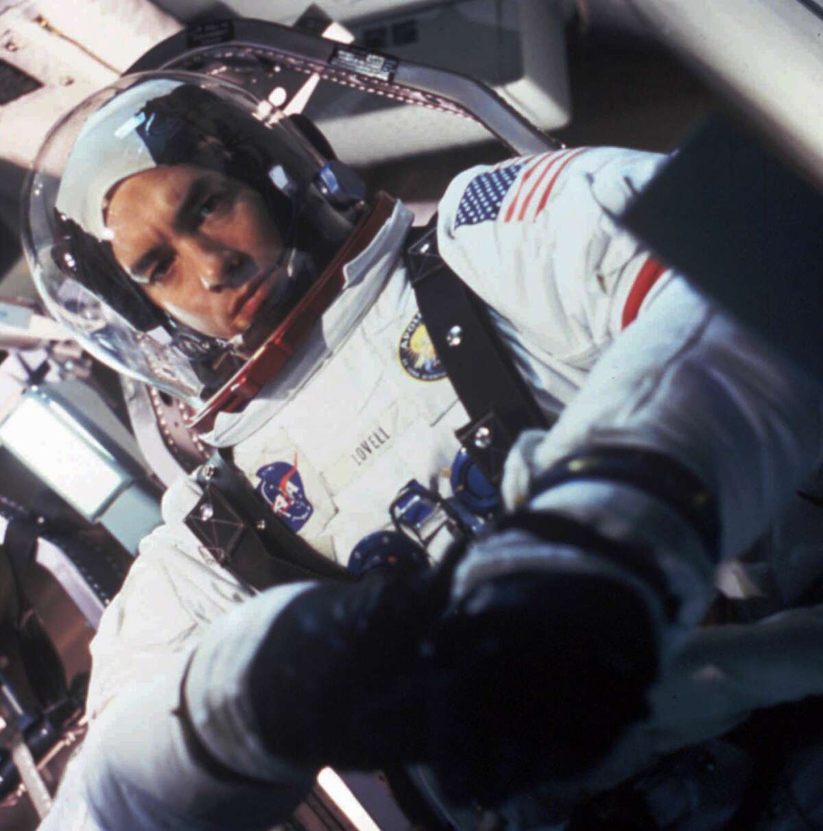 """Actor Tom Hanks is shown in character as astronaut Jim Lovell in the movie """"Apollo 13."""" The film, directed by Ron Howard, tells the story of the ill-fated 1970 moon shot. Two days after the spacecraft was launched on April 11, 1970, an oxygen tank blew, knocking out the electrical system and stranding the three-man crew somewhere between the Moon and Earth. With the help of an ingenious ground crew and the astronauts' own resourcefulness, they made it back alive."""