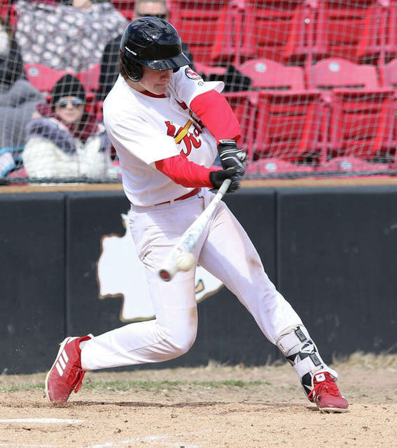 Alton's Robby Taul, shown getting a hit in a game earlier this season at Granite City, had three hits Monday in the Redbirds' victory over Carlyle at GCS Ballpark in Sauget. Photo: Greg Shashack / The Telegraph
