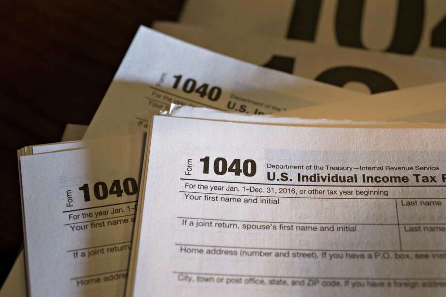 U.S. Department of the Treasury Internal Revenue Service 1040 Individual Income Tax forms. Photo: File Photo / © 2017 Bloomberg Finance LP