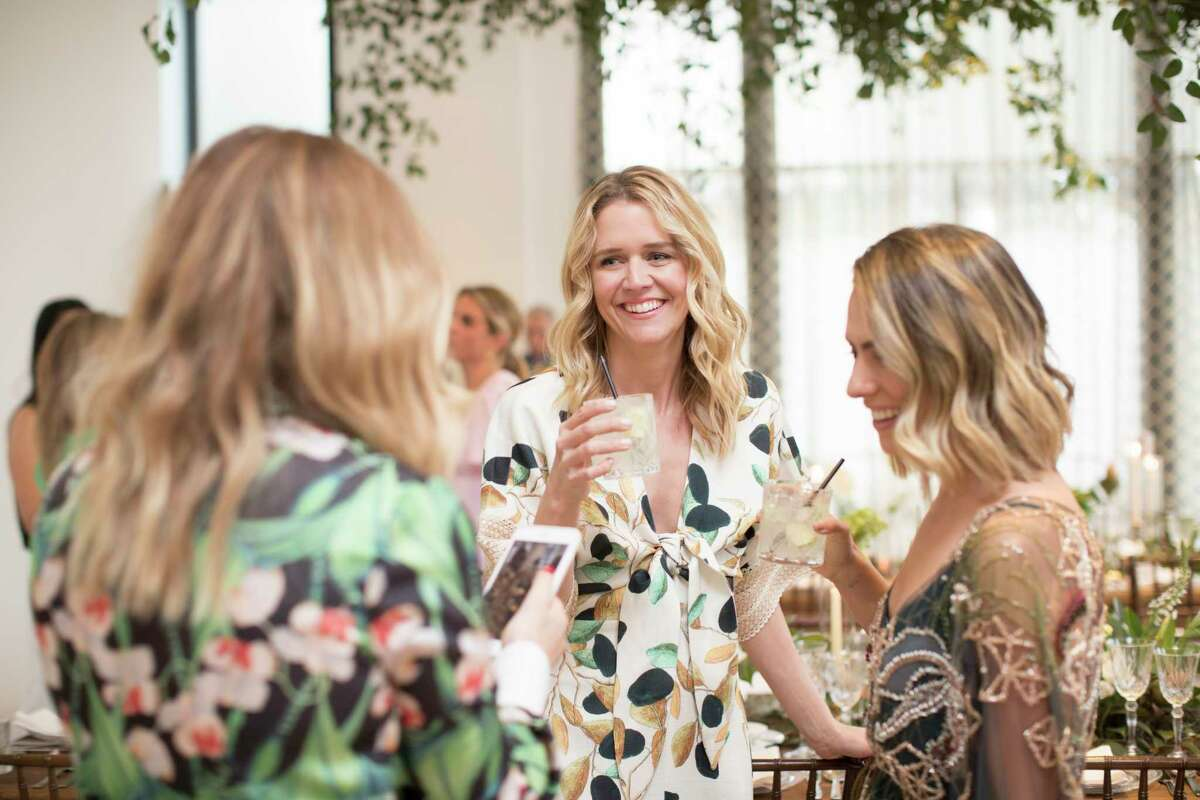 Guests mingle at Tootsies during an event dedicated to the fashion line PatBo on Thursday, March 28, 2019, in Houston.