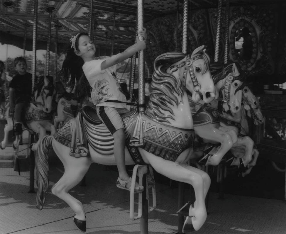 Click through the slideshow to see historical photos of Capital Region carousels. Altamont Fair, New York - Five-year-old Jasmine Holmberg of Albany, riding a winner at the fair. August 20, 1994 (Luanne M. Ferris/Times Union Archive)