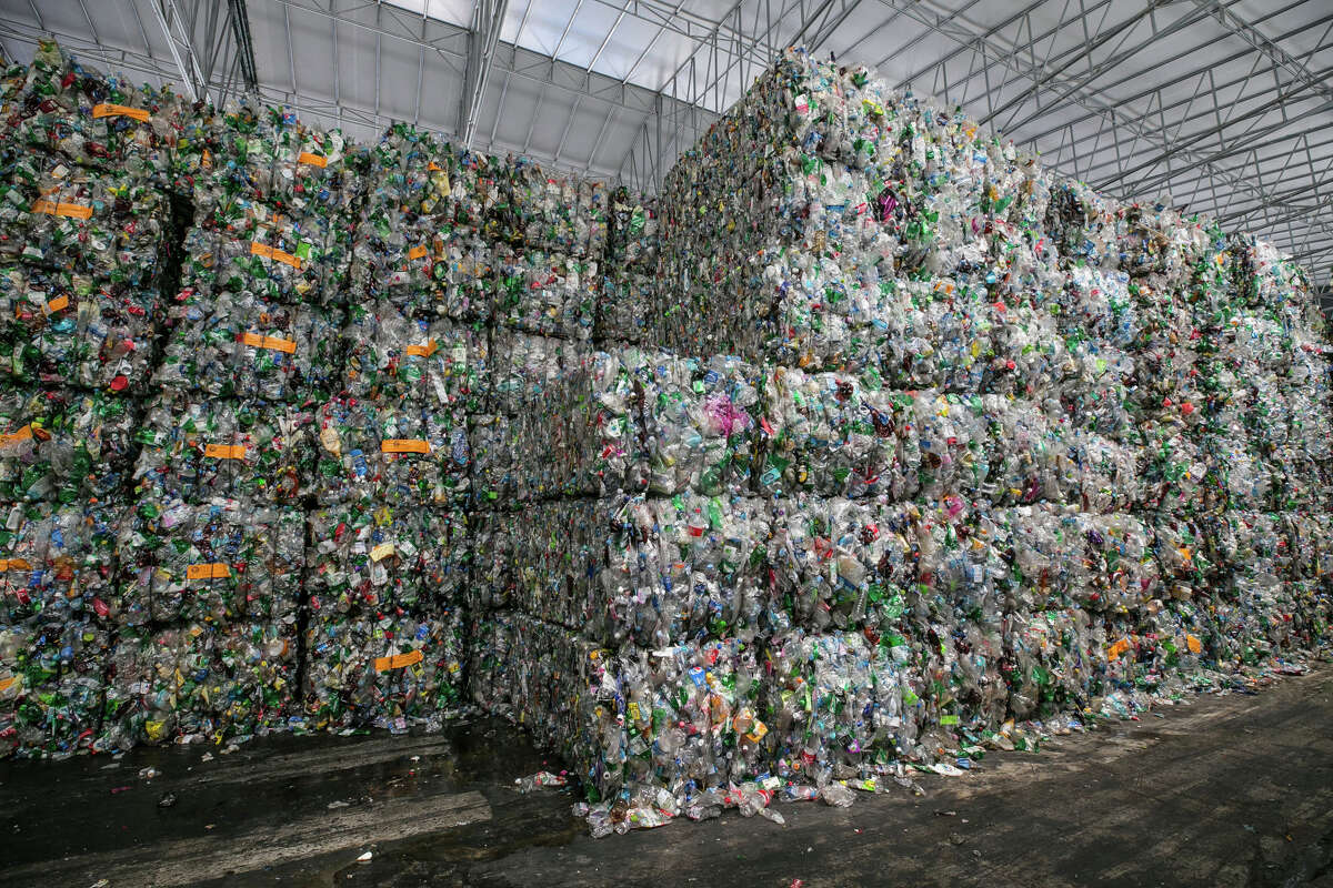 Bales of compressed plastic waste stand at a Junyoung Industrial facility in Gimpo, South Korea, in April 2018.