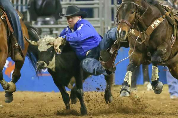 Will Lummus wins the Steer Wrestling championship during the Rodeo Championship finals of the Houston Rodeo at NRG Stadium in Houston, Texas. The rodeo generated $227 million in economic impact.