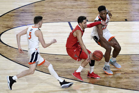 The replay reversal of Virginia's De'Andre Hunter, right, knocking the ball away from Texas Tech's Davide Moretti late in overtime and handing possession to the Cavaliers was a key moment in Monday's NCAA championship game and remains a hot topic of conversation.