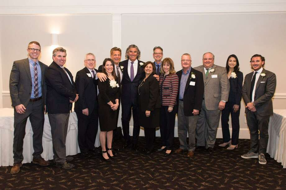 Seven local businesses and individuals, winners of the 2018 Shoreline Chamber of Commerce Awards, were recognized Feb. 21 in the Grand Ballroom of Amarante's Sea Cliff in New Haven. The ceremony kicked off with a keynote presentation from Lieutenant Governor Susan Bysiewicz. Legislators and local leaders were special guests, and Mark Dixon, WFSB Eyewitness News Meteorologist, officiated the award presentation. Winners were Community Service Award - John Saville, John Saville Entertainment Co.; Tourism Award - Brian McGlone, Town of Guilford; Volunteer of the Year Award - Peter Sikes, Shoreline Pixels; Special Board of Directors Award - Laura Burban, Executive Director, Dan Cosgrove Animal Shelter; Employer of the Year - East River Energy; Small Business of the Year - Branford Academy of Hair & Cosmetology; and New Business of the Year - Pressed and Dressed. Photo: Contributed Photo / Photo Credit: Mark L. Johnson - / © Copyright Mark L. Johnson - markjohnson.photo