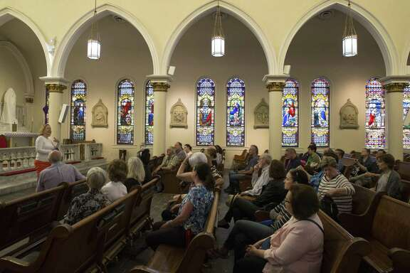 "Becky Lao, executive director of Archaeology Now, gives a breif introduction St. Joseph Church to the ""Ciao Houston Heritage Tour"" participants as a part of the Italian culture and history tour in the historic 6th Ward on Saturday, April 6, in Houston. The church was completed and dedicated in 1902 and was the heart and soul of this Sicilian American community, according to the tour."