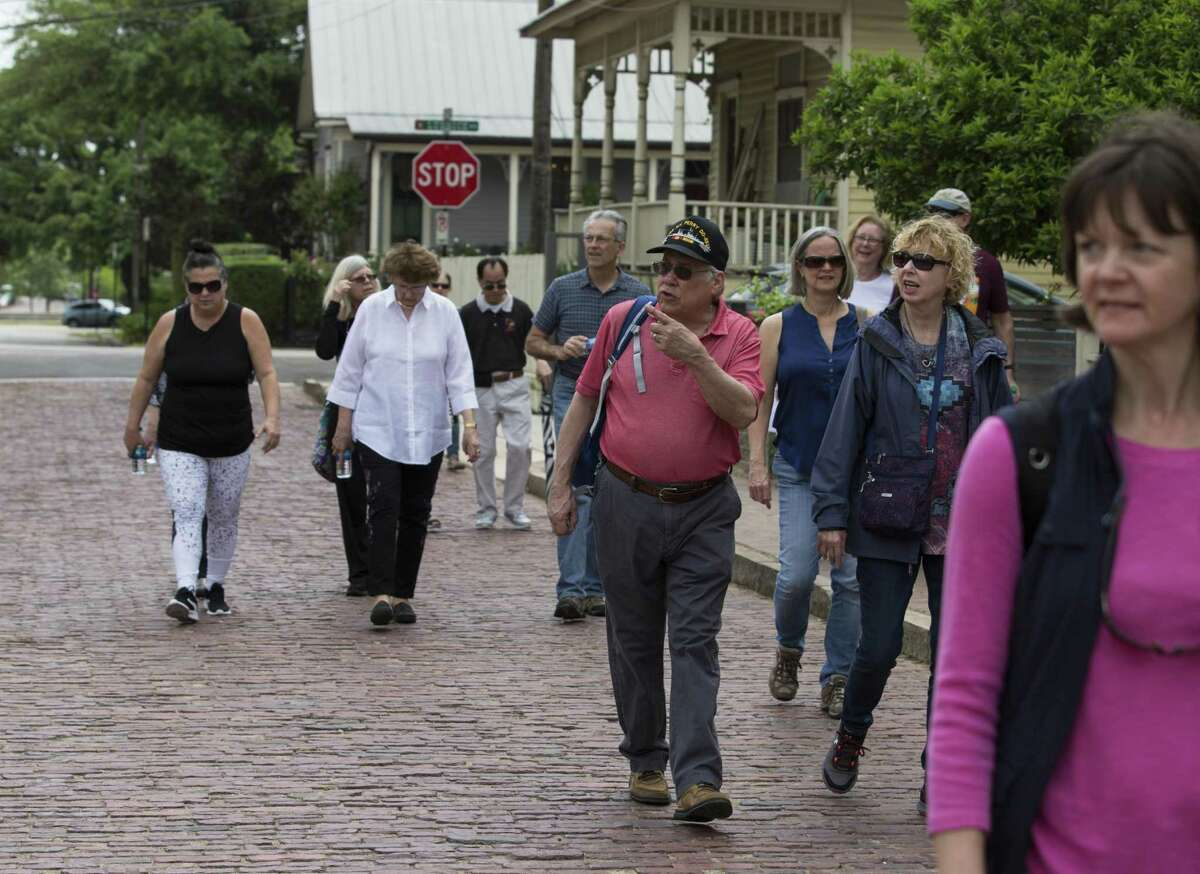 """The """"Ciao Houston Heritage Tour"""" participants walk along the brick pavement on Sabine Street between Lubbock and Washington while exploring the Italian culture and history in the historic 6th Ward on Saturday, April 6, in Houston. Most of the bricks were original, the City of Houston used new bricks to fill the holes. The tour, provided by Archaeology Now, focused on the Italian American - particularly Sicilian Americans - history in the community. Salvador's family were Sicilian immigrants who settled in the neighborhood."""