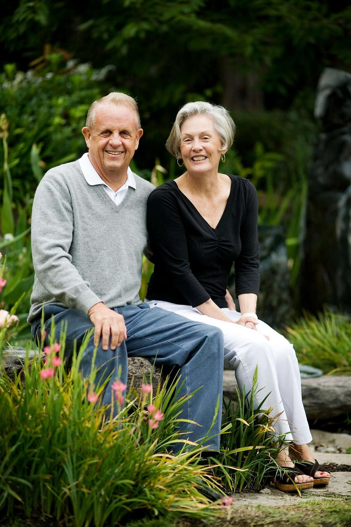 Vintner Dick Grace and his wife, Ann, of Grace Family Vineyards, in St. Helena, who created the first cult Cabernet, sit together near a koi pond in their backyard, on Monday, August 31, 2009. The Grace family has dedicated their life to nonprofit causes throughout Asia.