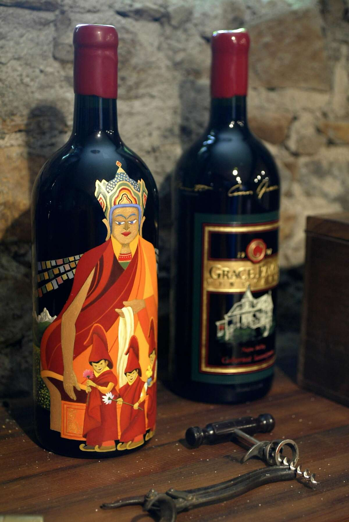 GRACE03240_cl.jpg Grace Family Winery in St. Helena. Bottles of etched and specially painted Grace Family wine bottles. Photo of a bottle on the left, painted by local artist in Calistoga, Lowell Herrero. It is a painting of the likeness of Buddha. It sold for $30, 000 and and the bottle was given back to remain in the Grace Family Winery collection. The person wanted to donate the money but wanted the bottle to stay in the Grace Family collection. Event on 5/17/04 in St. Helena. Craig Lee / The Chronicle Ann and Dick Grace bought their St. Helena home in 1975 and planted a small Cabernet vineyard there. Today, their wine helps raise funds for children. Ann and Dick Grace bought their St. Helena home in 1975 and planted a small Cabernet vineyard there. Today, their wine helps raise funds for children.